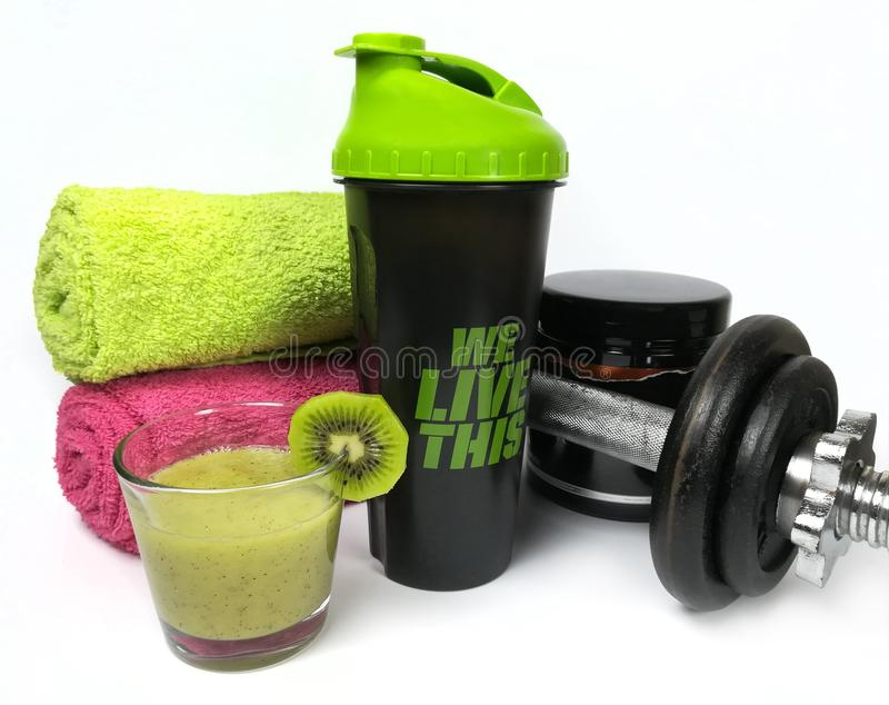 Concept with health and fitness stuff with fruits and weights royalty free stock images