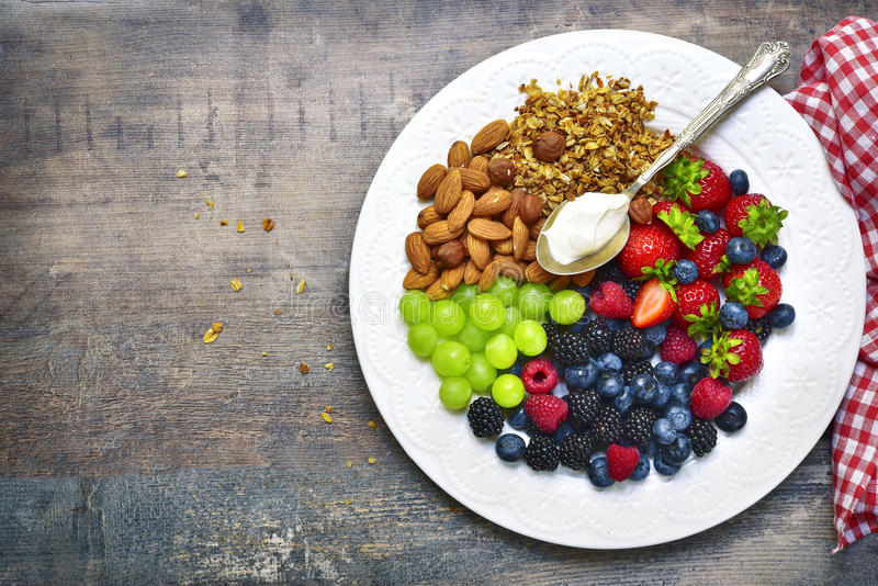Download Concept Of Healthy Breakfast : Granola,nuts,fresh Berries And Yo Stock Image - Image of blue, barley: 83455403