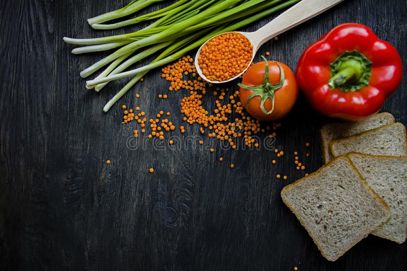 The concept of healthy eating. Balanced healthy eating background. Lentils, white bread, vegetables, greens on a dark wooden stock images