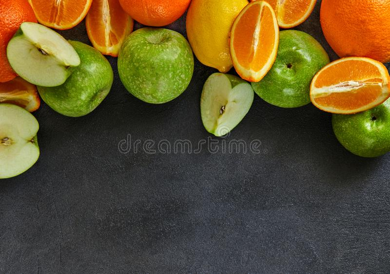 The concept of healthy eating, fresh citrus and apples royalty free stock photos