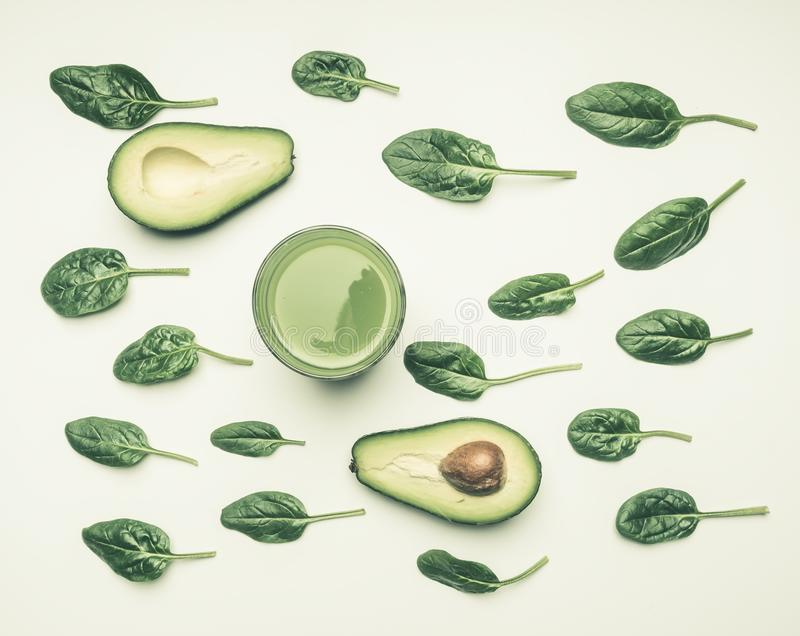 Concept of healthy eating, spinach leaves, avocado, smoothies on white background, flat lay stock photos