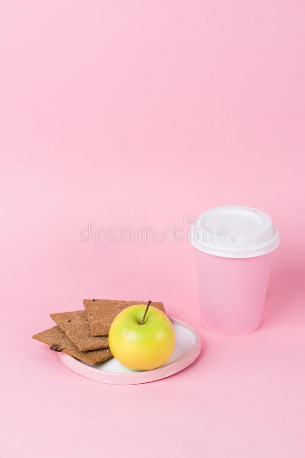 Concept healthy fashion breakfast. Diet crispy bread, apple and stock photography
