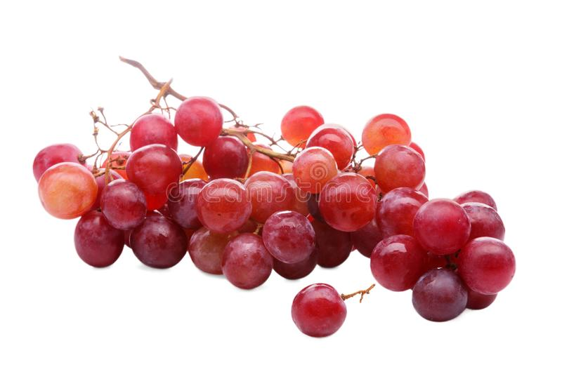 Healthy food. Close-up of fresh ripe bunch of grapes isolated on white background stock photo