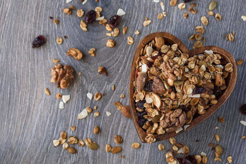 Homemade granola in wooden bowl. Concept healthy food. homemade granola in wooden bowl stock image