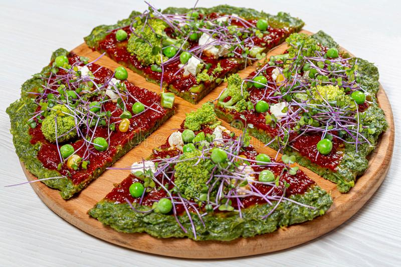 The concept of healthy food. Pizza with vegetables and micro greens cabbage & x28;Flip 2019 royalty free stock image