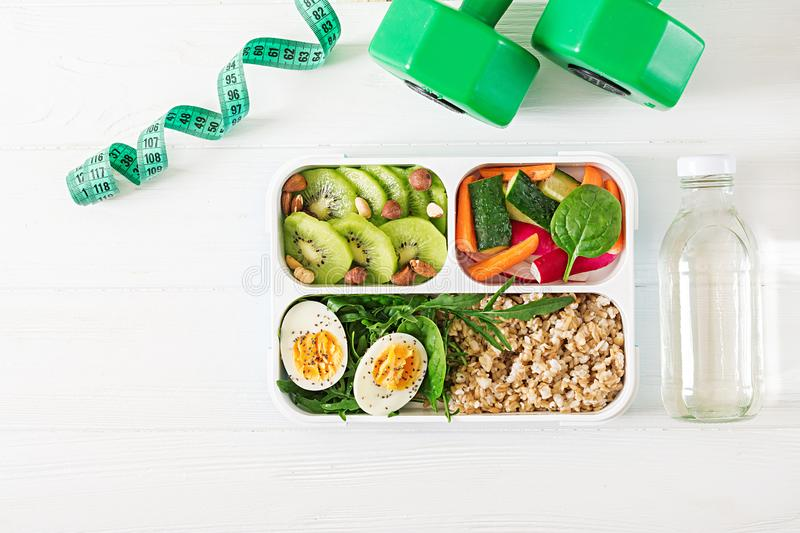 Concept healthy food and sports lifestyle. Vegetarian lunch. Healthy breakfast. Proper nutrition. Lunchbox. Top view. Flat lay. Concept healthy food and sports stock photos