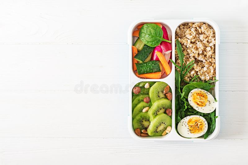 Concept healthy food and sports lifestyle. Vegetarian lunch. Healthy breakfast. Proper nutrition. Lunchbox. Top view. Flat lay royalty free stock photo