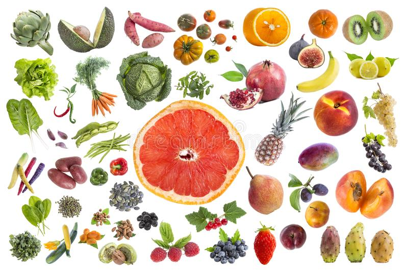 Concept of healthy food, Various Fruits and vegetables to eat five a day on withte background with grapfruit slice royalty free stock photography