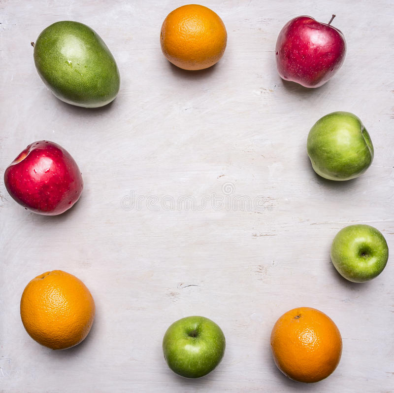 Concept of healthy food, vitamins, various fruits, various apples, mangoes, oranges lined frame place text wooden rustic b stock photos