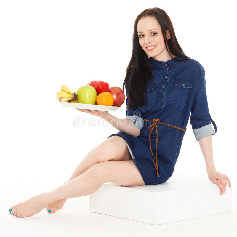 Concept of healthy food. Young beautiful woman with fresh fruits and vegetables on a white background. Concept of healthy food stock photo