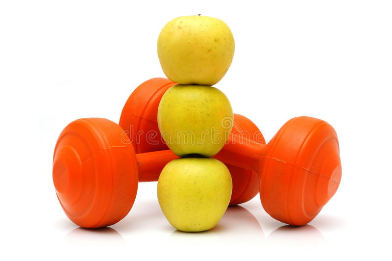 Concept of healthy life with apples and weights stock photo