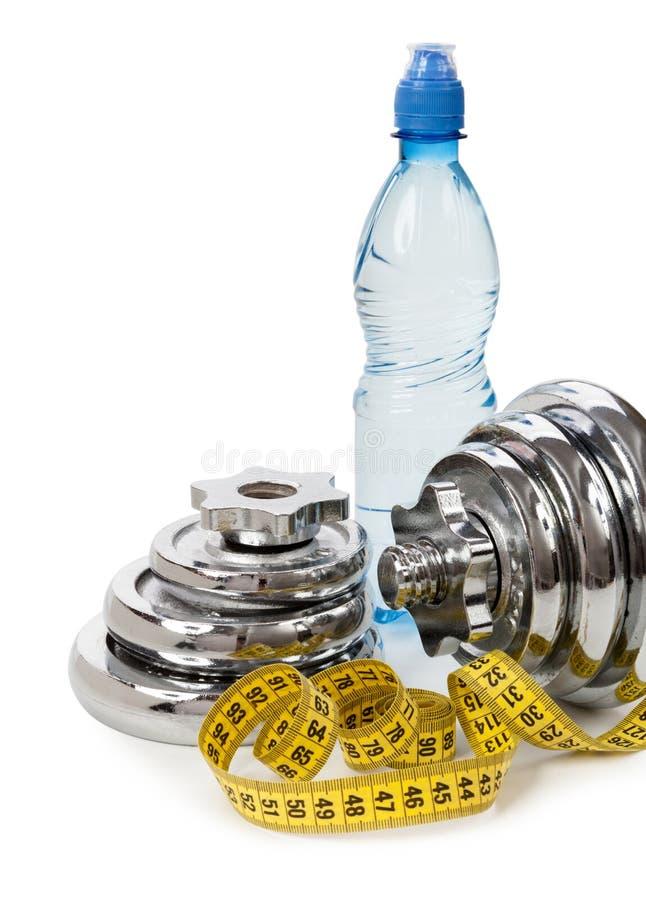 concept healthy lifestyle Вода, гантели, измеряя лента стоковая фотография