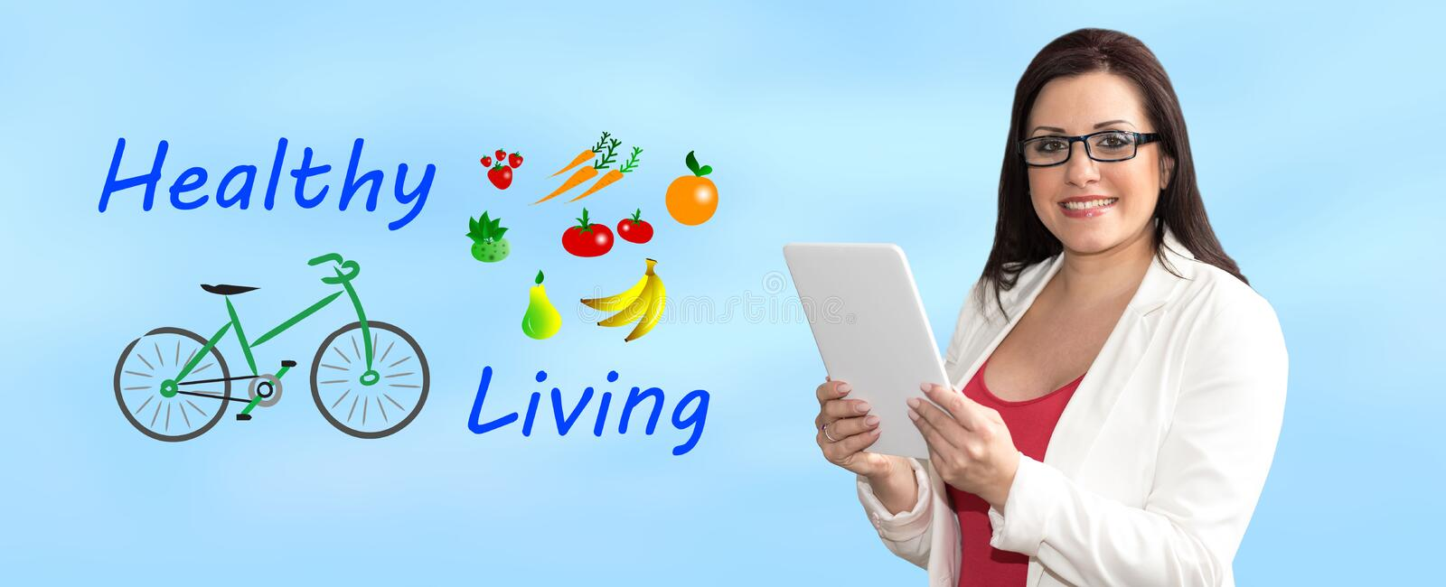 Concept of healthy living. Woman using digital tablet with healthy living concept on background royalty free stock image