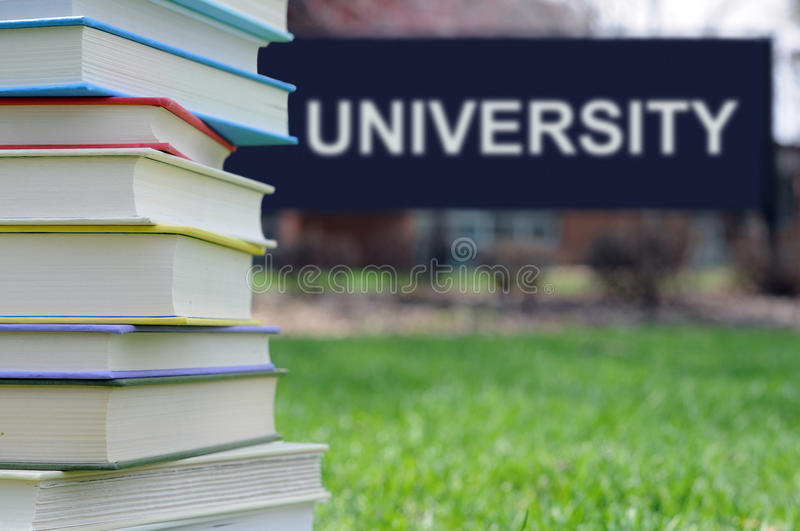 Concept of higher education. Books on campus of university: concept of higher education stock images