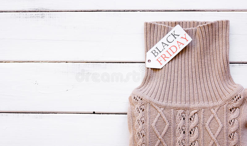 Concept holiday sales of clothes and textiles top view. On wooden background stock image