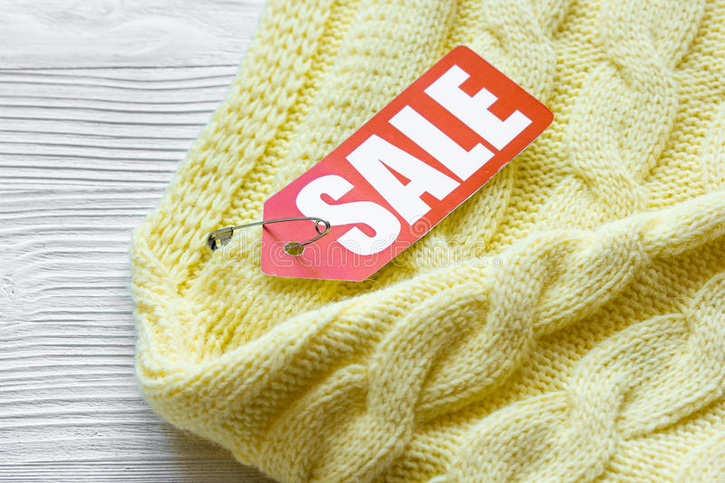 Concept holiday sales of clothes and textiles. On wooden background stock photography
