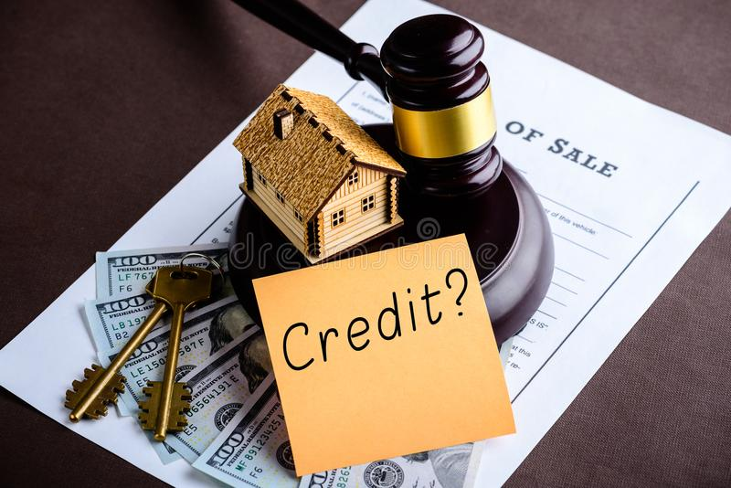 Concept of home loan and credit. Little wooden house, judges gavel, dollar money and Million Dollars Question on the sticker. Top royalty free stock photography
