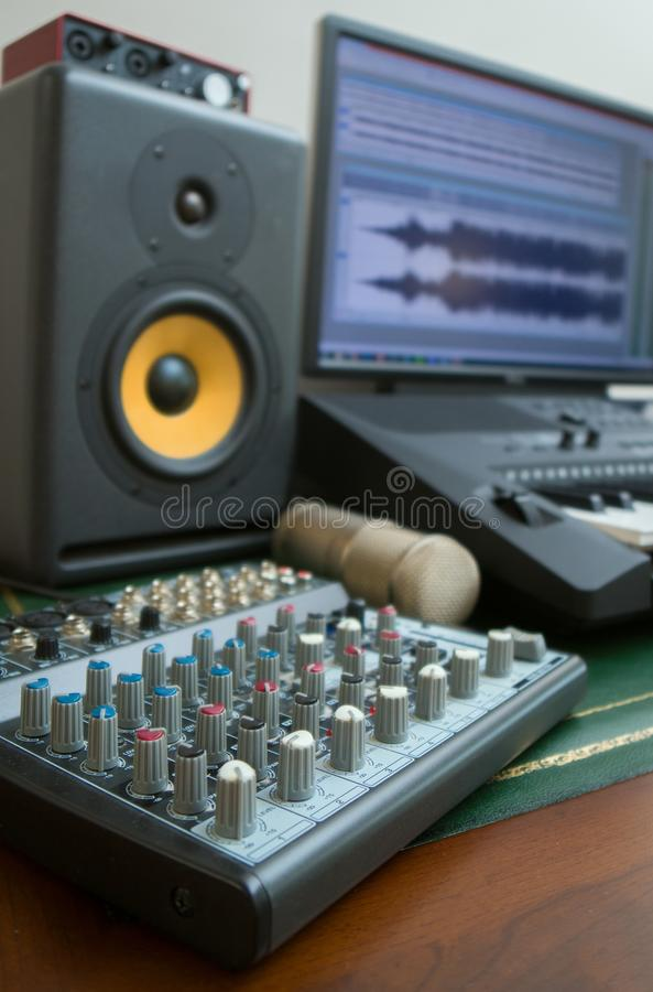 Concept of home music studio. Mixer, condenser microphone and professional monitor. Concept of home music studio stock images
