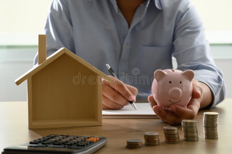 The concept of home ownership Business people negotiating a contract This is where you need to sign. D royalty free stock photo