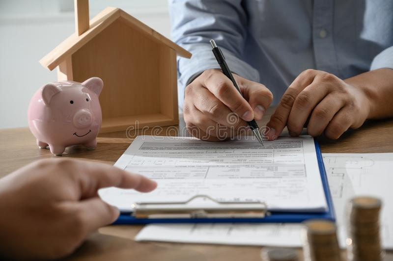 The concept of home ownership Business people negotiating a contract This is where you need to sign. D royalty free stock photos