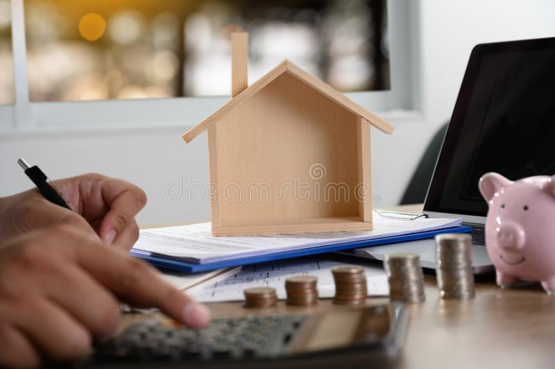 The concept of home ownership Business people negotiating a contract This is where you need to sign stock photos