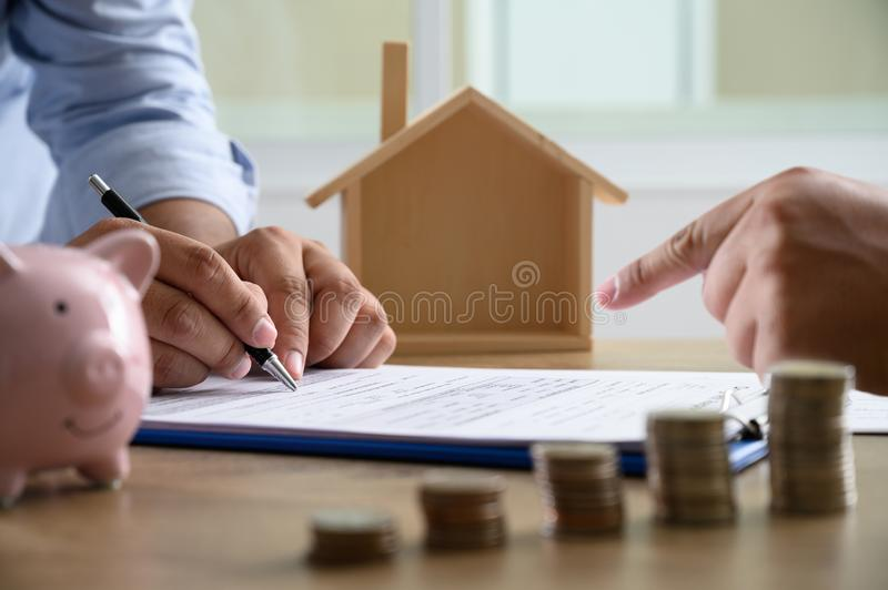 The concept of home ownership Business people negotiating a contract This is where you need to sign royalty free stock photo