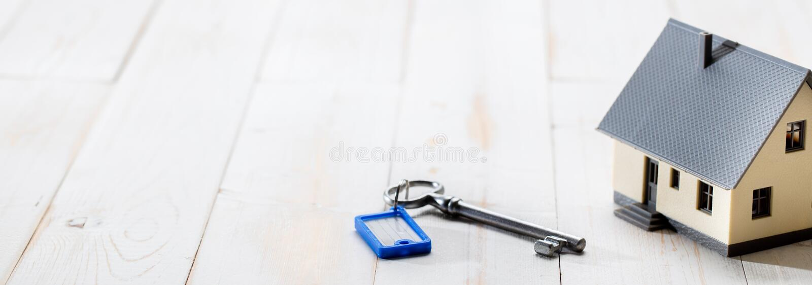 Concept of home ownership, rental or investment with house key. Concept of house ownership, rental, investment, residential future with a key and home set on stock image