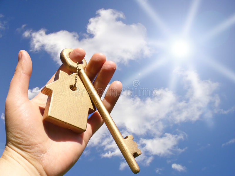 Concept for homeownership. Business concept. The golden key, or reaching for the sky to home ownership royalty free stock image