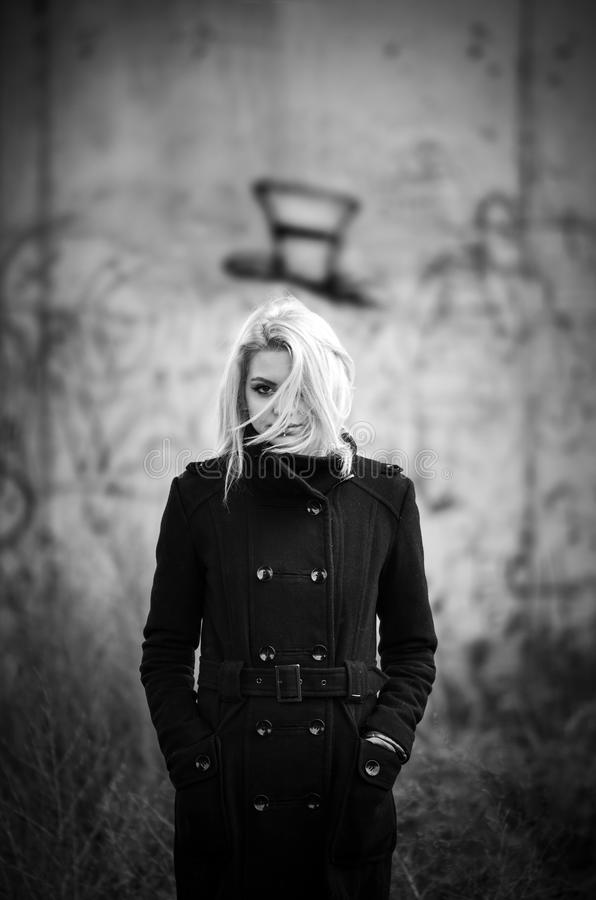 Concept horror design with girl in black coat royalty free stock image