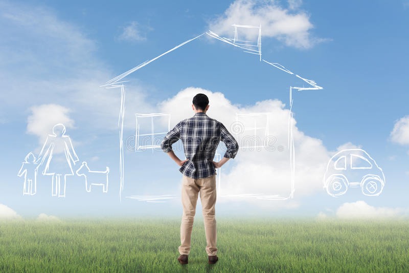 Concept of house. Asian man look toward the drawing house and family in the heaven royalty free stock photo