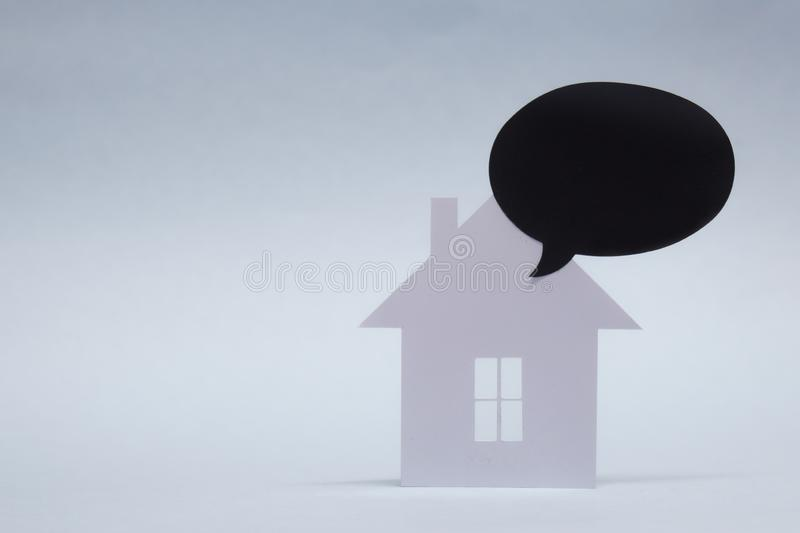 Concept of house from paper with Mock-up black chalk board on white background. Horizontal composition royalty free stock image