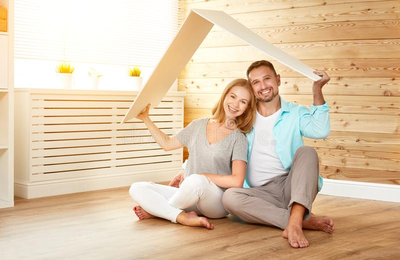 Ept housing a young family. couple in new home. Concept housing a young family. couple in a new home stock images