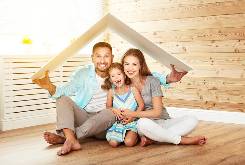 Concept housing young family. Mother father and child in new h stock image
