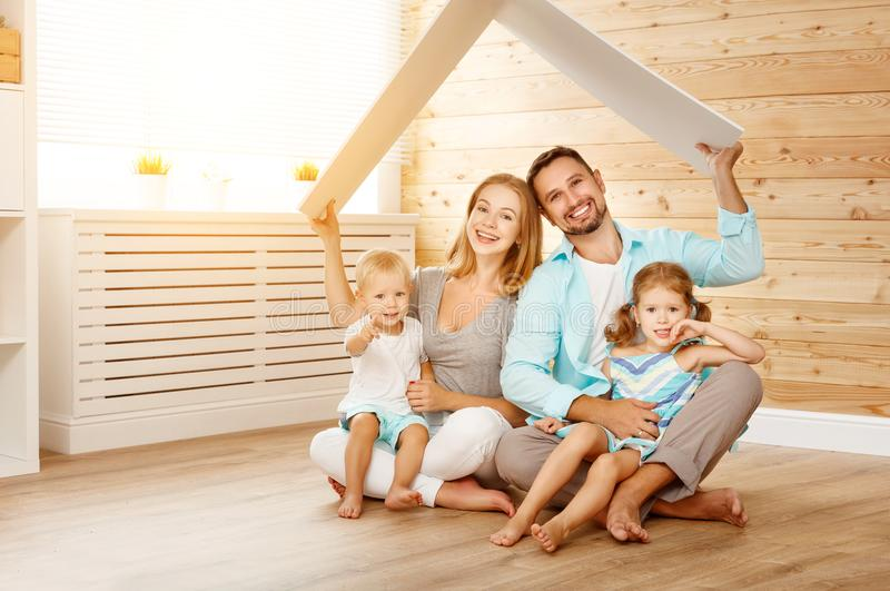 Concept housing a young family. mother father and children in n royalty free stock photography