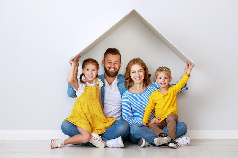 Concept housing a young family. mother father and children in  new home stock images