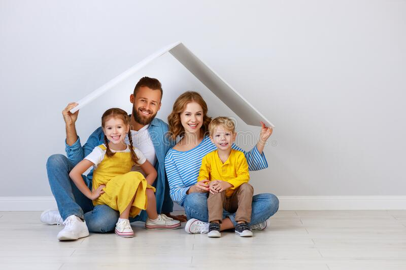 Concept housing a young family. mother father and children in  new home stock photo
