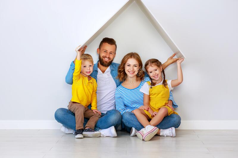 Concept housing a young family. mother father and children in  new home royalty free stock photos