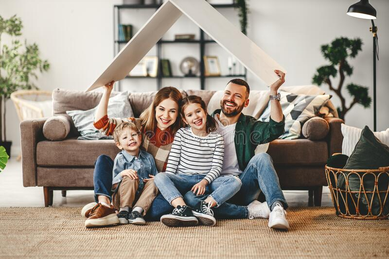 Concept housing a young family. mother father and children in  new home stock photography