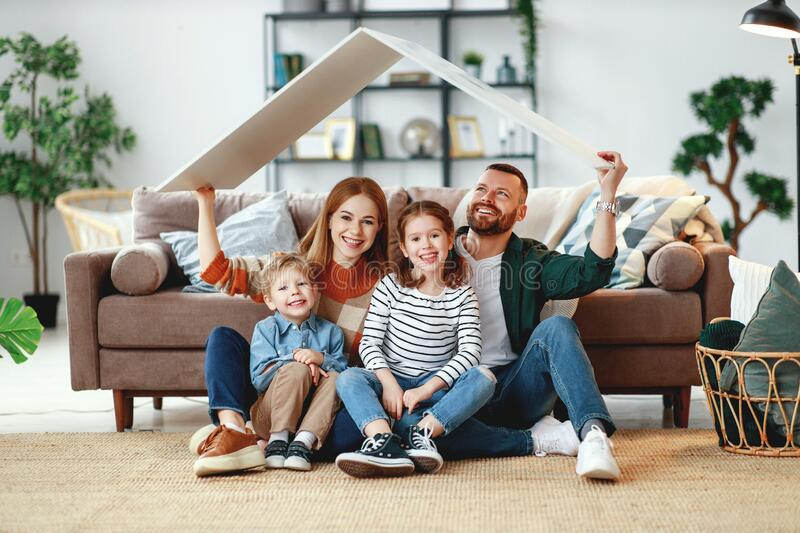 Concept housing a young family. mother father and children in  new home stock image