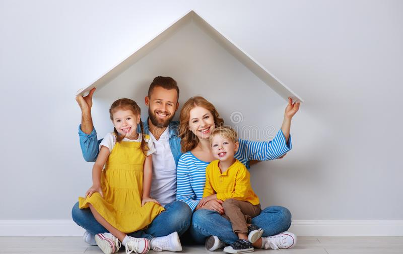Concept housing a young family. mother father and children in  new home stock photos