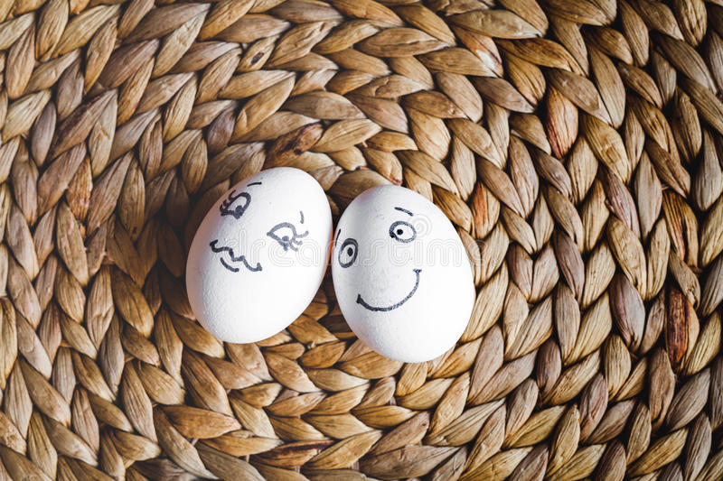 Concept human relationships and emotions eggs - flirtation. Concept human relationships and emotions eggs flirtation on mat top view royalty free stock photography