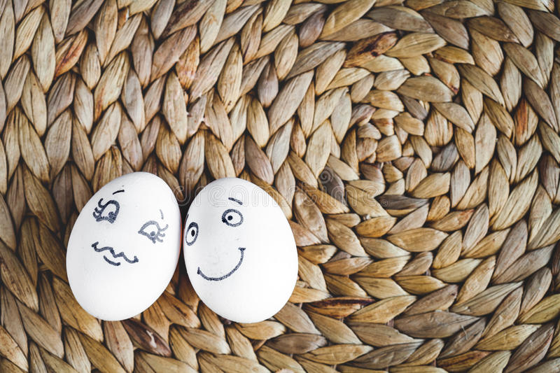 Concept human relationships and emotions eggs - smile. Concept human relationships and emotions eggs smile on mat top view royalty free stock images