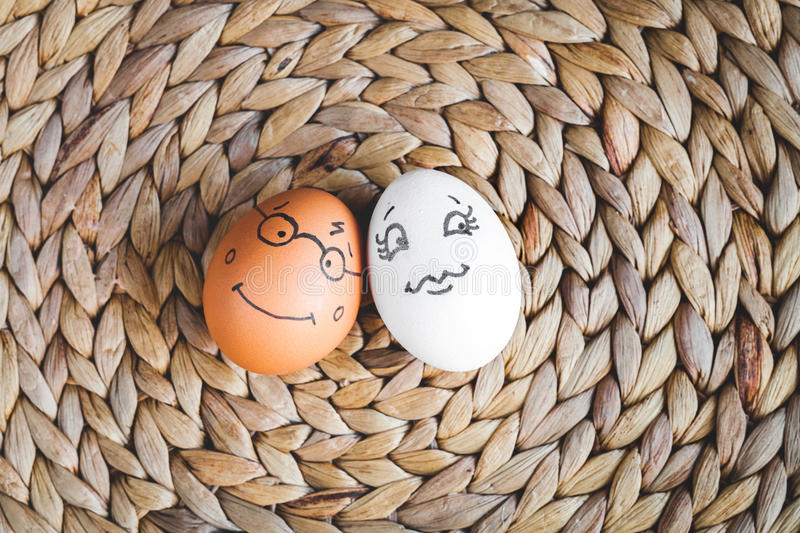 Concept human relationships and emotions eggs - smile. Concept human relationships and emotions eggs smile on mat top view stock photography
