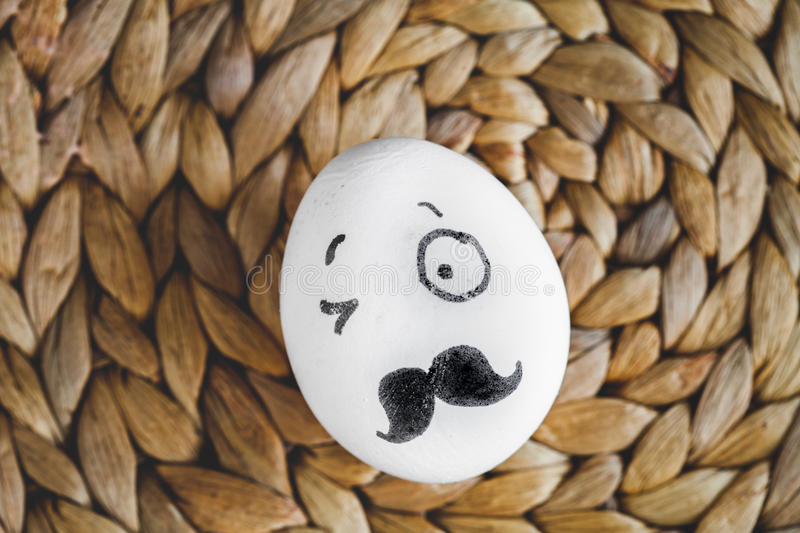 Concept human relationships and emotions eggs - wink. On mat top view royalty free stock photo