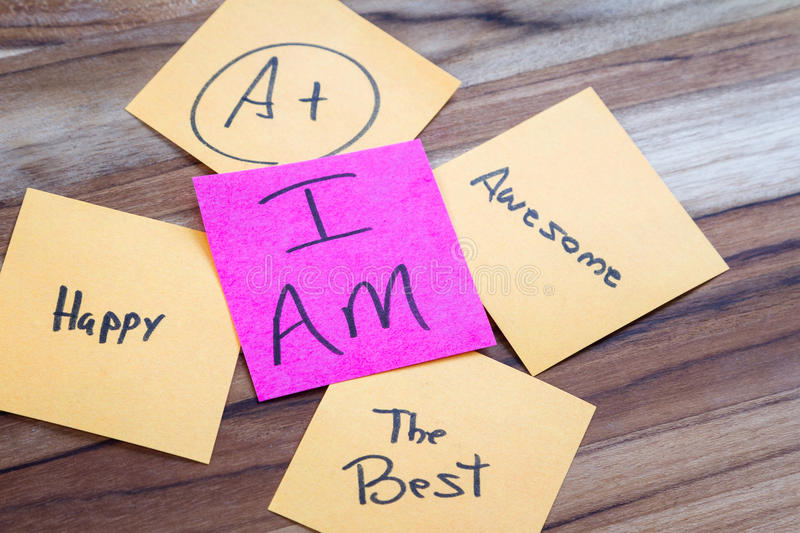 Concept for I am. Very powerful self help concept using positive messages and a I am floating above all the positive thoughts royalty free stock image