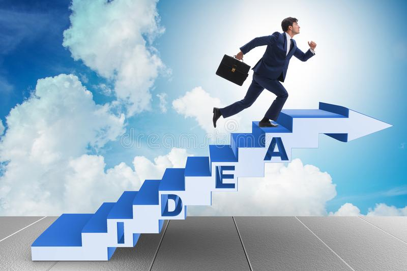 the concept of idea with businessman climbing steps stairs stock