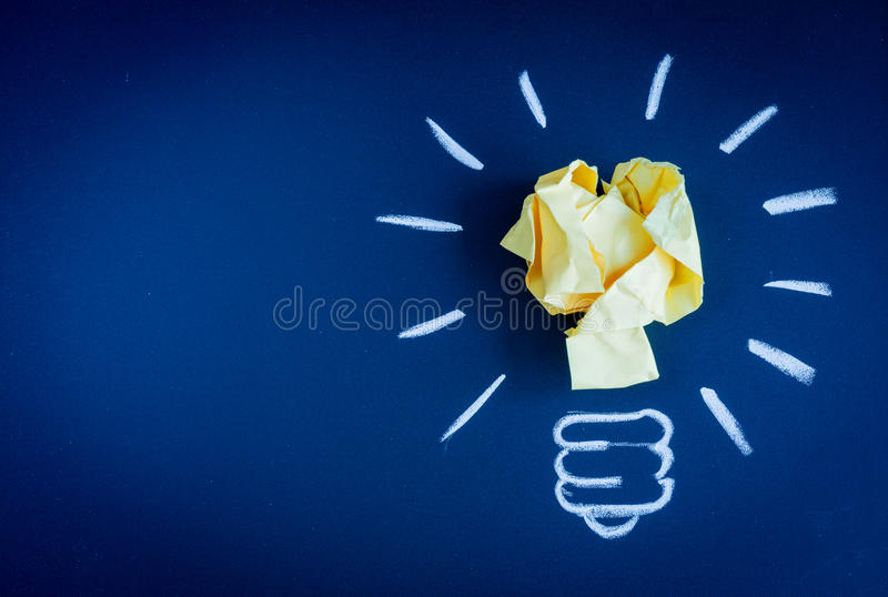 Concept idea inspiration with lamp dark background top view. Concept idea inspiration with lamp on dark background top view stock photography