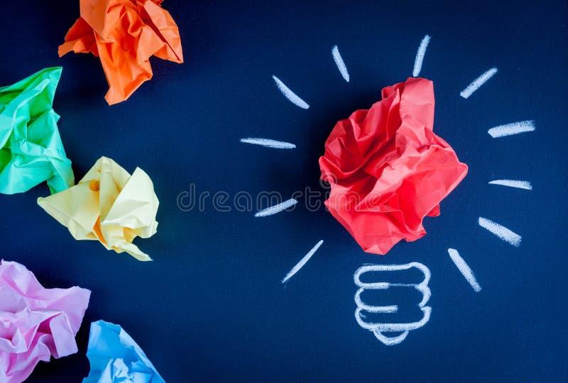 Concept idea inspiration with lamp dark background top view. Concept idea inspiration with lamp on dark background top view stock photo