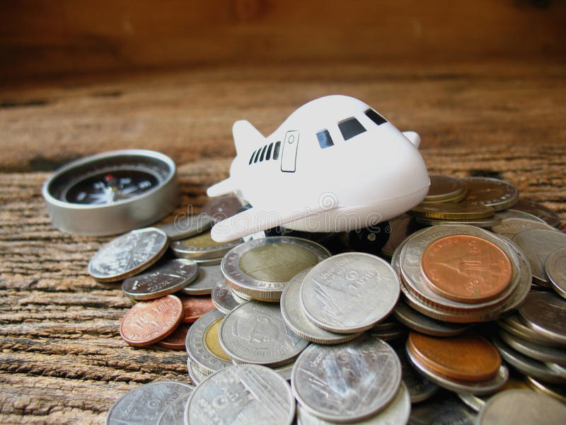 Concept idea save money for travel, airplane toy to go on top ma. Ny coin royalty free stock photography