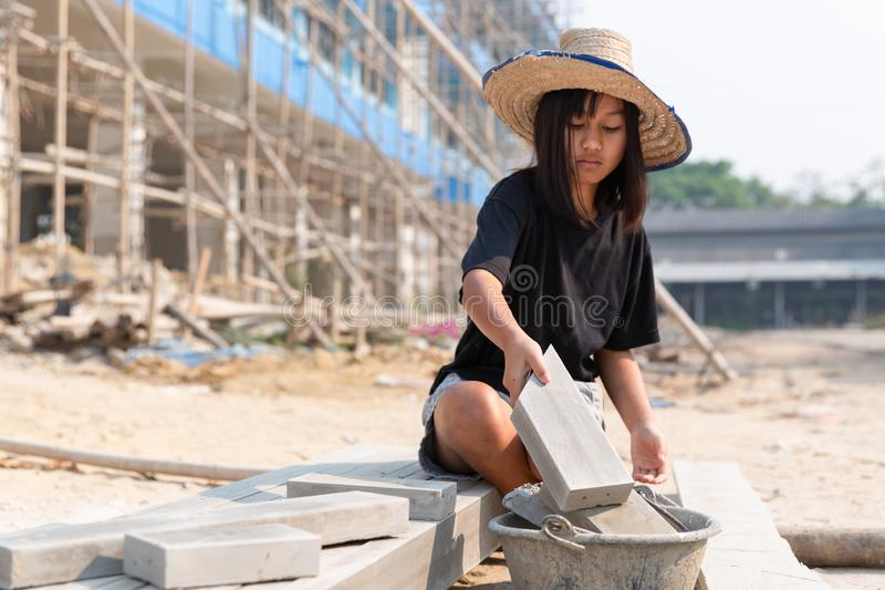 The concept of illegal child labor, Children are forced to work construction. Children violence and trafficking,   Rights Day on. December 10 royalty free stock photos